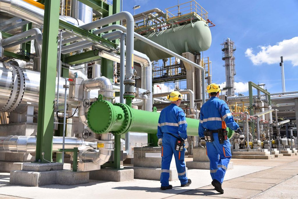 Engineer at industrial plant looking for flue gas heat recovery options